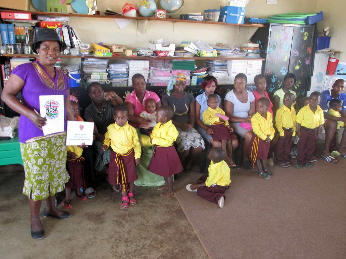 donated new school uniform to children with their parents